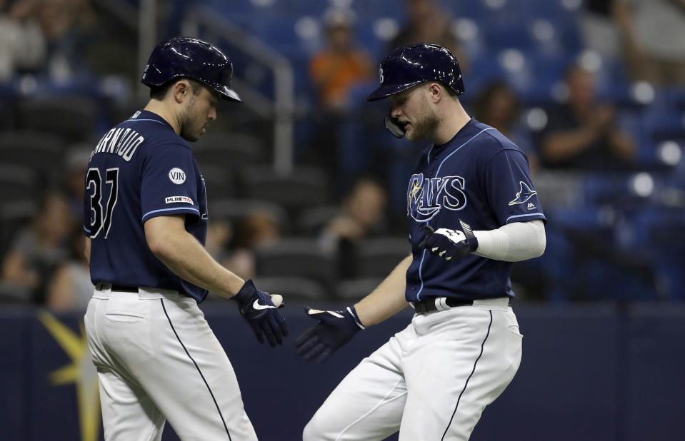 Tampa Bay Rays' Austin Meadows, right, celebrates with on-deck batter Travis d'Arnaud after Meadows hit a solo home run off Baltimore Orioles starting pitcher Gabriel Ynoa during the fourth inning of the second baseball game of a doubleheader Tuesday, Sept. 3, 2019, in St. Petersburg, Fla. (AP Photo/Chris O'Meara)