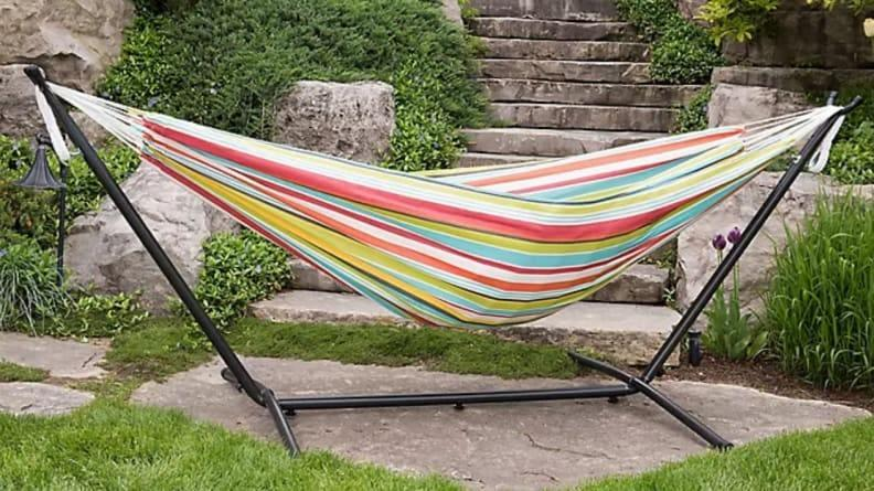 This colorful hammock comes with a metal stand.