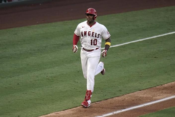 Los Angeles Angels' Justin Upton runs toward home after hitting a two-run home run against the Houston Astros during the fifth inning of the first baseball game of a doubleheader, Saturday, Sept. 5, 2020, in Anaheim, Calif. (AP Photo/Jae C. Hong)