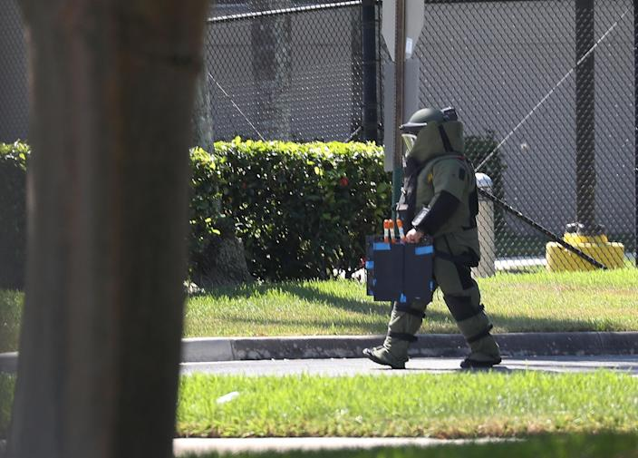 <p>A member of the Broward Sheriff's Office bomb squad is seen as he investigates a suspicious package in the building where Rep. Debbie Wasserman Schultz (D-FL) has an office on Oct. 24, 2018 in Sunrise, Fla. (Photo: Joe Raedle/Getty Images) </p>