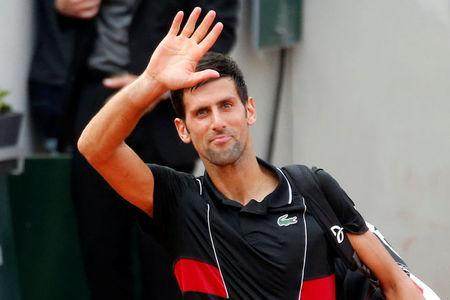 FILE PHOTO: Tennis - French Open - Roland Garros, Paris, France - June 5, 2018 Serbia's Novak Djokovic acknowledges the crowd after losing his quarter final match against Italy's Marco Cecchinato REUTERS/Pascal Rossignol