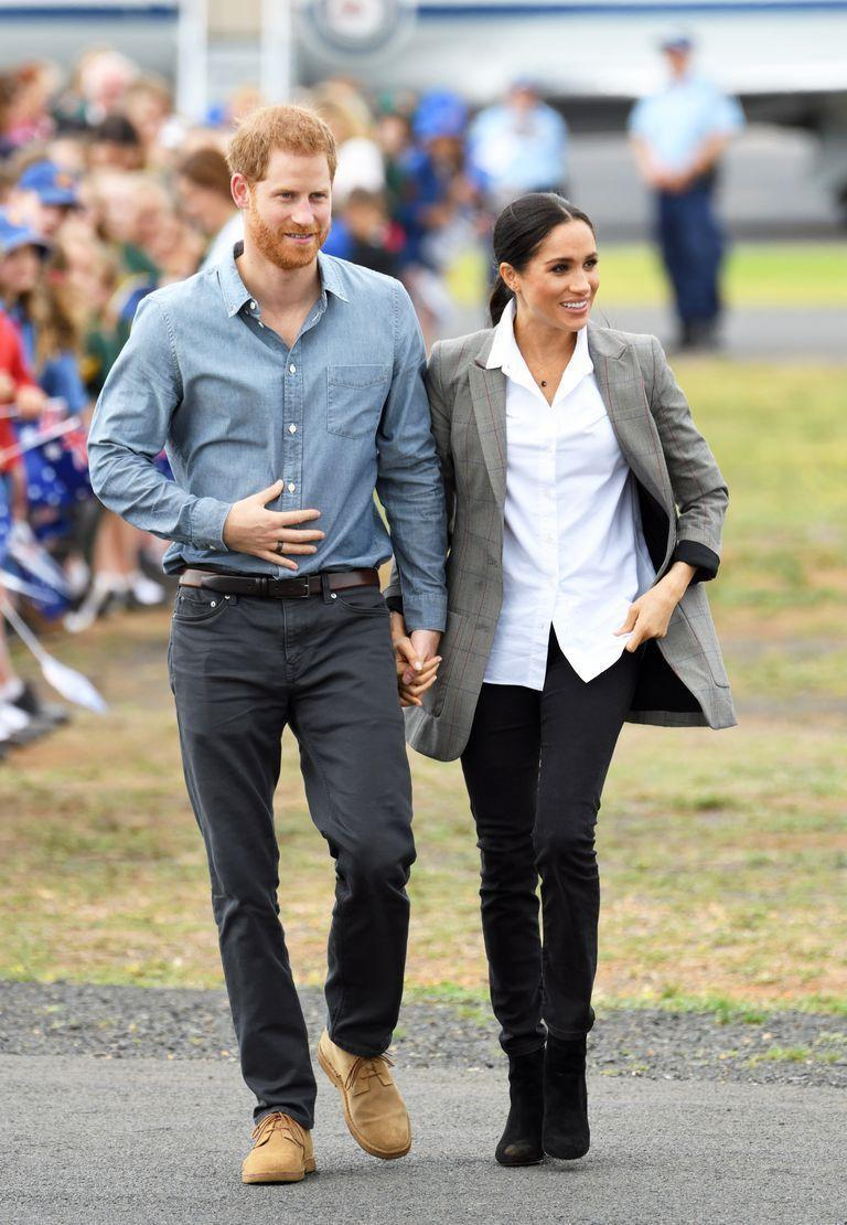 """<p>For her first day in Dubbo and the second day of hers and Prince Harry's major royal tour of Australia, Meghan a top from <a href=""""https://www.farfetch.com/uk/shopping/women/762802-designer-maison-kitsune/items.aspx"""" rel=""""nofollow noopener"""" target=""""_blank"""" data-ylk=""""slk:Maison Kitsuné"""" class=""""link rapid-noclick-resp"""">Maison Kitsuné</a>, jeans by <a href=""""https://www.whitehair.co/releases/outlanddenim"""" rel=""""nofollow noopener"""" target=""""_blank"""" data-ylk=""""slk:Outland Denim"""" class=""""link rapid-noclick-resp"""">Outland Denim</a>, boots from <a href=""""https://www.jcrew.com/us/p/womens_category/shoes/boots/sadie-ankle-boots-in-suede/K0055?srcCode=affiliate%7CBloggers%7CSkimlinks%7CAFFI0001&siteId=CJ_3640649_Skimlinks&cjevent=f40fa51ed1e511e883d400440a180514"""" rel=""""nofollow noopener"""" target=""""_blank"""" data-ylk=""""slk:J.Crew"""" class=""""link rapid-noclick-resp"""">J.Crew</a>and a grey blazer from her best friend and tennis star <a href=""""https://www.serenawilliams.com/collections/launch/products/boss-oversized-blazer"""" rel=""""nofollow noopener"""" target=""""_blank"""" data-ylk=""""slk:Serena William's collection"""" class=""""link rapid-noclick-resp"""">Serena William's collection</a>.</p>"""