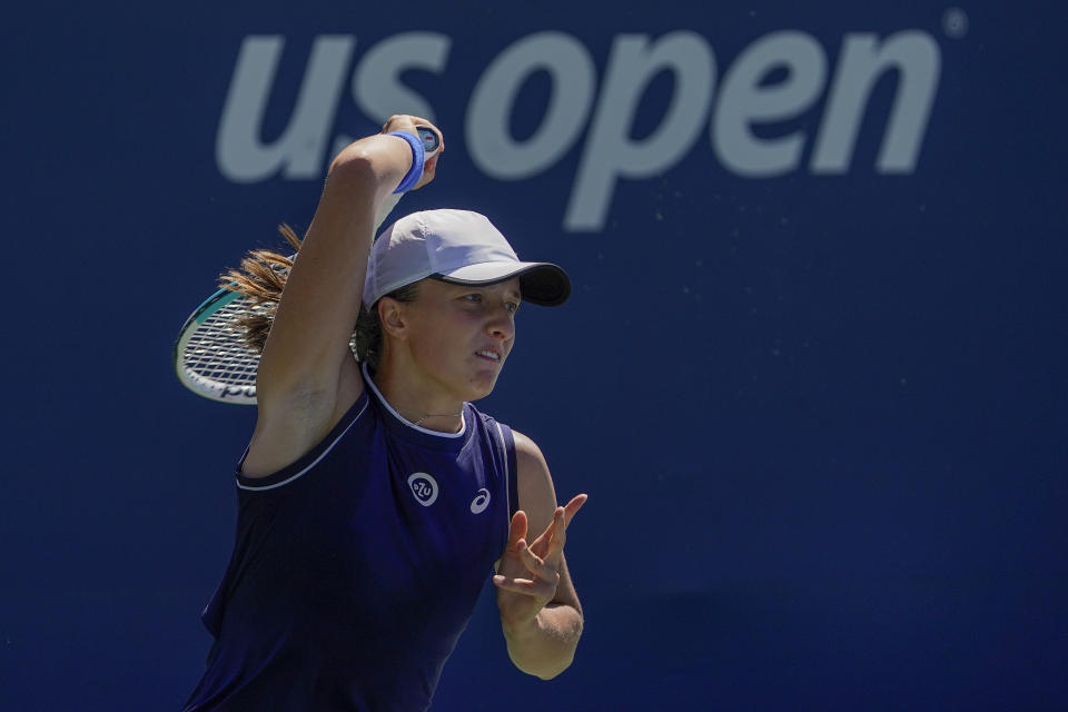 Iga Swiatek, of Poland, returns a shot to Fiona Ferro, of France, during the second round of the US Open tennis championships, Thursday, Sept. 2, 2021, in New York. (AP Photo/Seth Wenig)