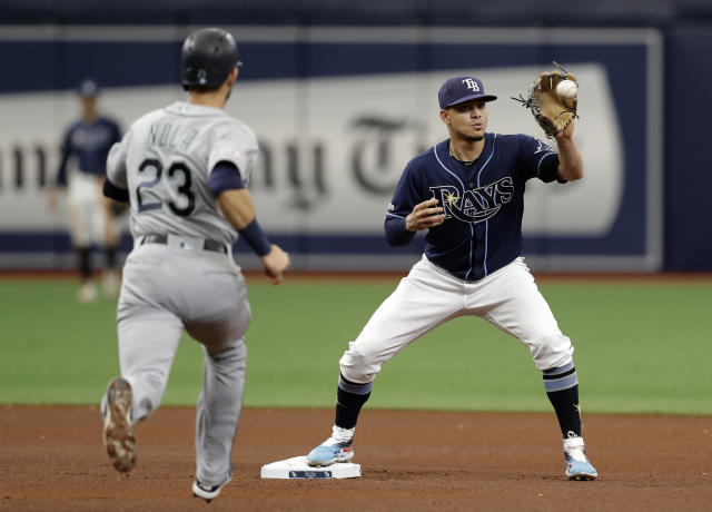Tampa Bay Rays shortstop Willy Adames forces Seattle Mariners' Austin Nola (23) at second base on a fielder's choice by Kyle Seager during the fourth inning of a baseball game Wednesday, Aug. 21, 2019, in St. Petersburg, Fla. (AP Photo/Chris O'Meara)