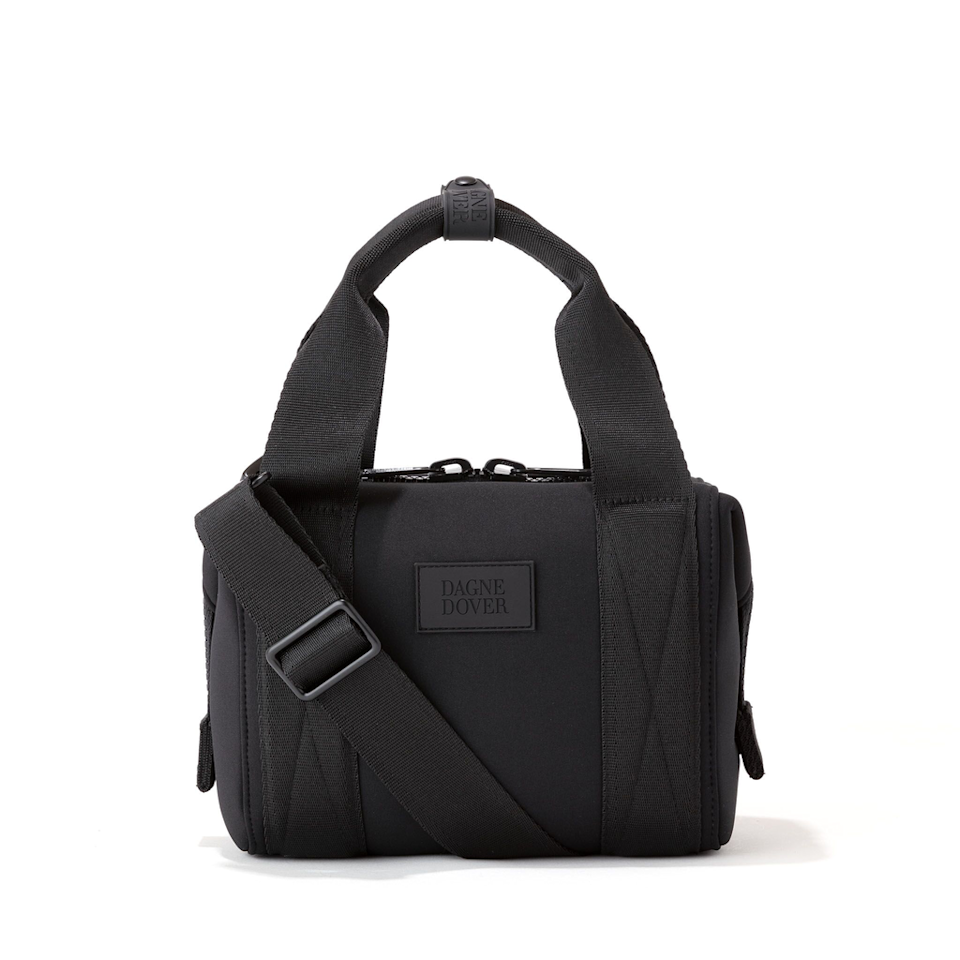 """<h3><a href=""""https://www.dagnedover.com/collections/the-landon-carryall"""" rel=""""nofollow noopener"""" target=""""_blank"""" data-ylk=""""slk:Dagne Dover Landon Carryall"""" class=""""link rapid-noclick-resp"""">Dagne Dover Landon Carryall</a></h3><br>A major top-seller from our <a href=""""https://refinery29.com/en-us/best-gym-bags-for-women"""" rel=""""nofollow noopener"""" target=""""_blank"""" data-ylk=""""slk:roundup of best gym bags"""" class=""""link rapid-noclick-resp"""">roundup of best gym bags</a>, Dagne Dover's utility-chic neoprene duffels can currently be snagged for up to 20% off their usual price. <br><br><strong>Dagne Dover</strong> Landon Carryall, $, available at <a href=""""https://www.dagnedover.com/collections/the-landon-carryall#Onyx-ExtraSmall"""" rel=""""nofollow noopener"""" target=""""_blank"""" data-ylk=""""slk:Dagne Dover"""" class=""""link rapid-noclick-resp"""">Dagne Dover</a>"""