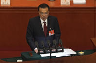 Chinese Premier Li Keqiang delivers a speech during the opening session of China's National People's Congress (NPC) at the Great Hall of the People in Beijing, Friday, March 5, 2021. China's No. 2 leader has set a healthy economic growth target and vowed to make this nation self-reliant in technology amid tension with Washington and Europe over trade and human rights. (AP Photo/Andy Wong)