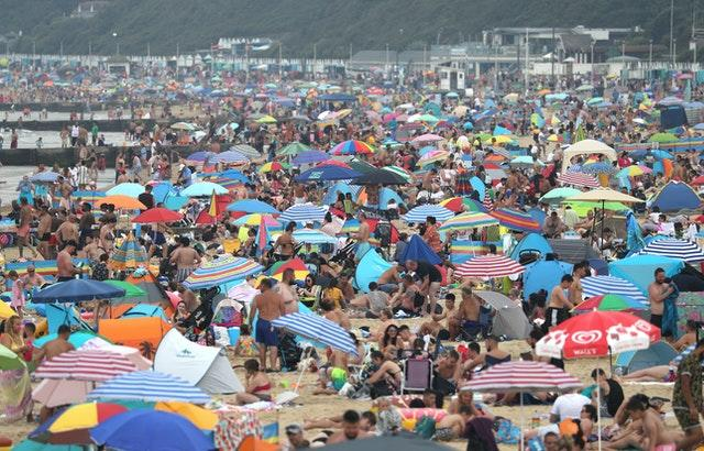 People enjoy the hot weather at Bournemouth beach in Dorset