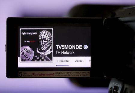 A print screen of the hacked Facebook page of French television network TV5Monde is seen on a camera viewer in Paris