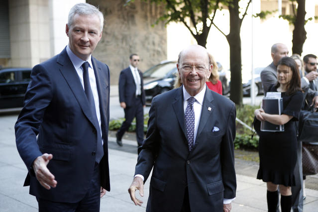French Finance Minister Bruno Le Maire, left, welcomes US Secretary of Commerce Wilbur Ross prior to their meeting at French Economy Ministry in Paris, France, Thursday, May 31, 2018. (AP Photo/Francois Mori)