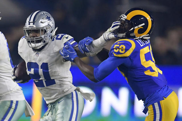 Dallas Cowboys running back Ezekiel Elliott pushes off Los Angeles Rams inside linebacker Cory Littleton during the first half in an NFL divisional football playoff game Saturday, Jan. 12, 2019, in Los Angeles. (AP Photo/Mark J. Terrill)