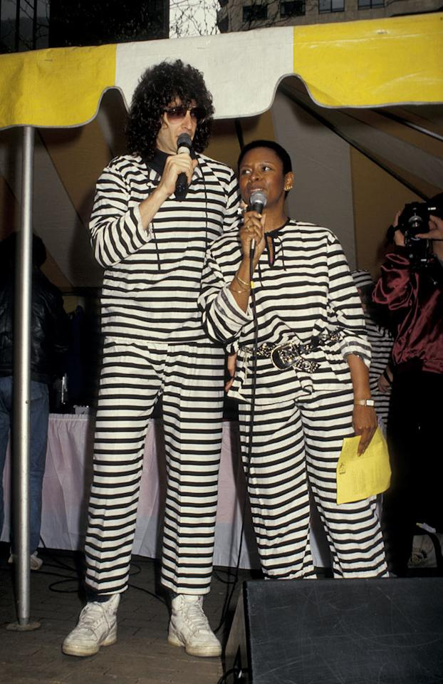 """Although they spend most of their time behind microphones making people laugh, Howard Stern and Robin Quivers have always been comfortable getting outside and rallying their fans. Here they are in 1987, during the dynamic duo's notorious early days at 92.3 K-Rock in New York. <a href=""""http://bit.ly/yVrlv3"""" rel=""""nofollow"""">View the entire gallery at Snakkle.</a>"""