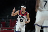 United States's Devin Booker (15) celebrates after three point basket during men's basketball semifinal game against Australia at the 2020 Summer Olympics, Thursday, Aug. 5, 2021, in Saitama, Japan. (AP Photo/Charlie Neibergall)