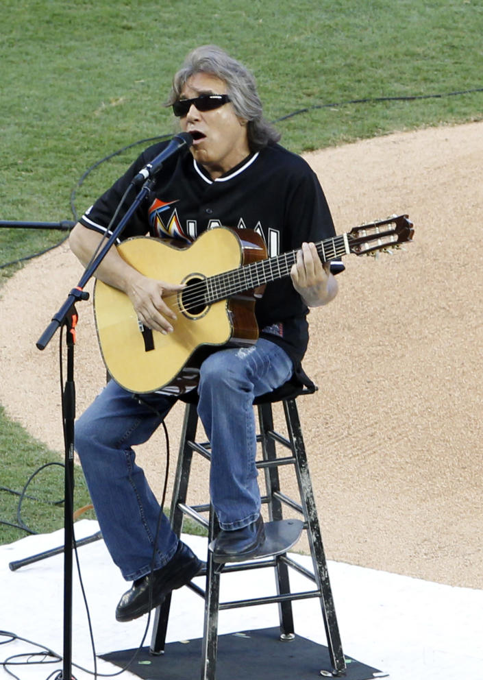 Jose Feliciano plays and sings the national anthem before the Opening Day baseball game between the Miami Marlins and the St. Louis Cardinals, Wednesday, April 4, 2012, in Miami. (AP Photo/Wilfredo Lee)