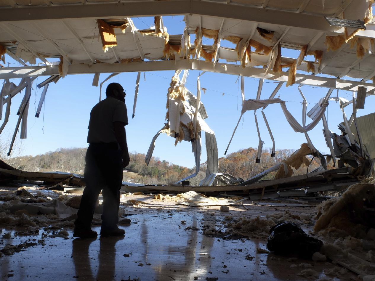 Fairview Baptist Pastor Carlos Mauricio surveys damage Thursday, Dec. 1, 2016, to the basketball gym where a tornado struck just hours after a game on Wednesday morning, at Fairview Christian Academy in Athens, Tenn. (Tim Barber/Chattanooga Times Free Press via AP)