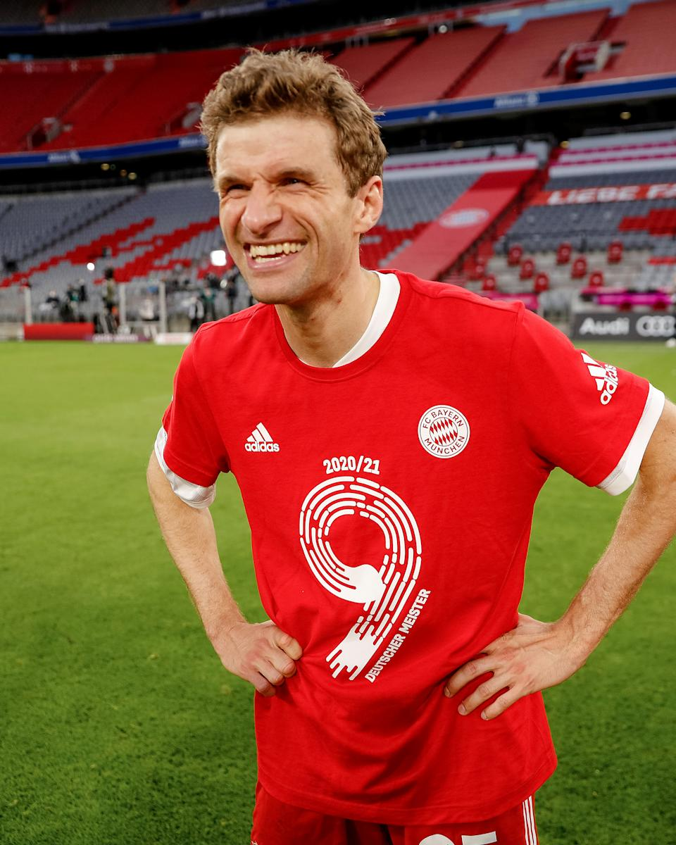 MUNICH, GERMANY - MAY 08: Thomas Mueller of Bayern Muenchen celebrates winning the league title after the Bundesliga match between FC Bayern Muenchen and Borussia Moenchengladbach at Allianz Arena on May 08, 2021 in Munich, Germany. Sporting stadiums around Germany remain under strict restrictions due to the Coronavirus Pandemic as Government social distancing laws prohibit fans inside venues resulting in games being played behind closed doors. (Photo by S. Mellar/FC Bayern via Getty Images)