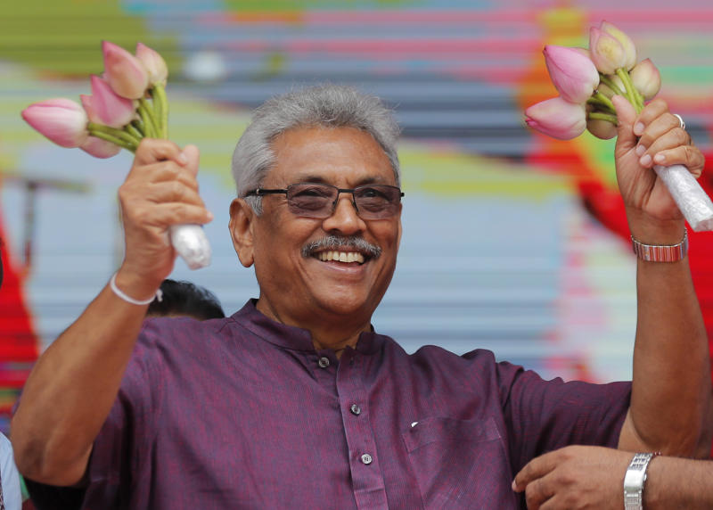 Sri Lankan presidential candidate and former defense chief Gotabaya Rajapaksa waves to his supporters during a rally in Neluwa village in Galle, Sri Lanka, Tuesday, Oct. 22, 2019. Rajapaksa is the front-runner in Sri Lanka's upcoming presidential election. (AP Photo/Eranga Jayawardena)