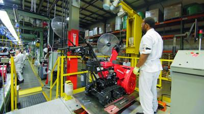 A Honda Power Equipment associate performs a quality check on a Honda snow thrower at the Swepsonville, NC plant