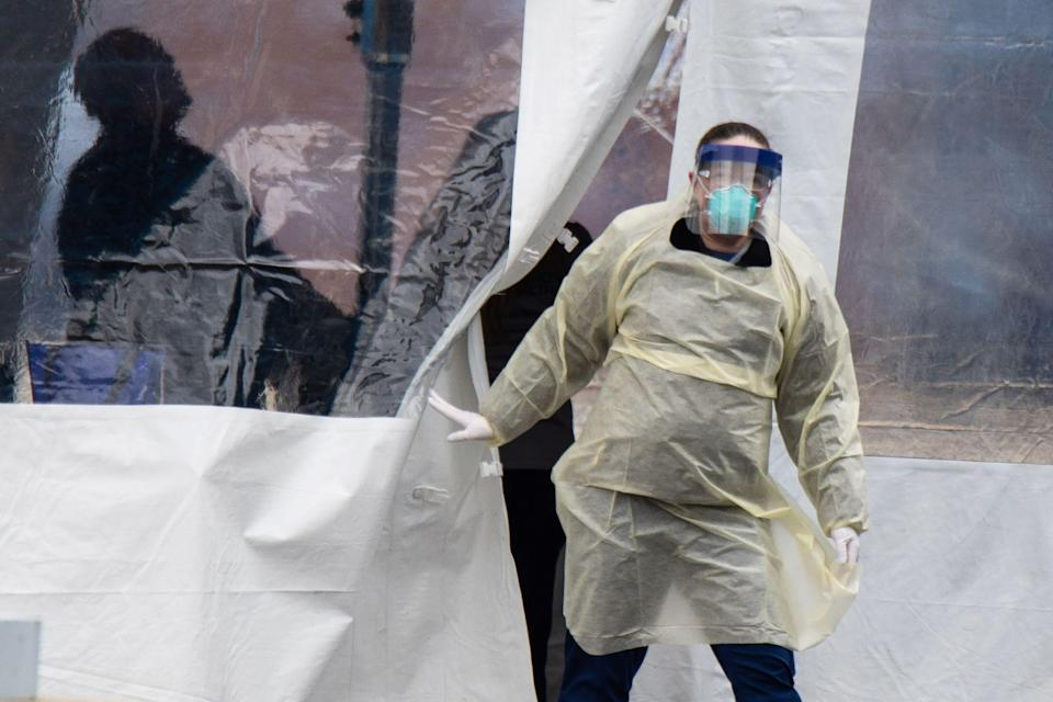 A health care worker walks out of a COVID-19 testing site in Dayton, Ohio.
