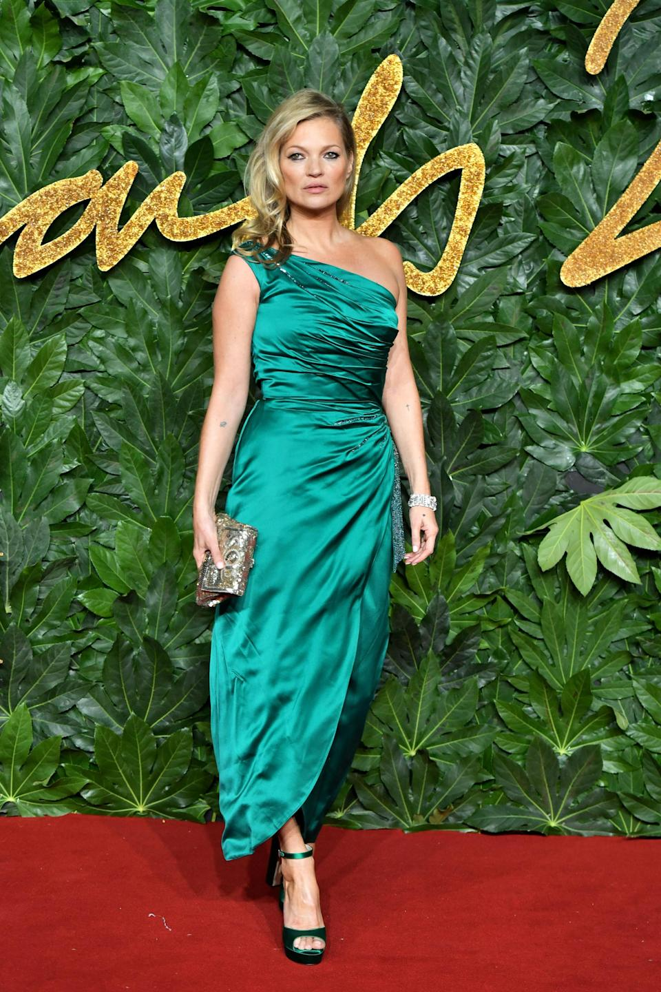 <p>The model wore an emerald one-shoulder dress at the Fashion Awards at the Royal Albert Hall. <em>[Photo: Getty]</em> </p>