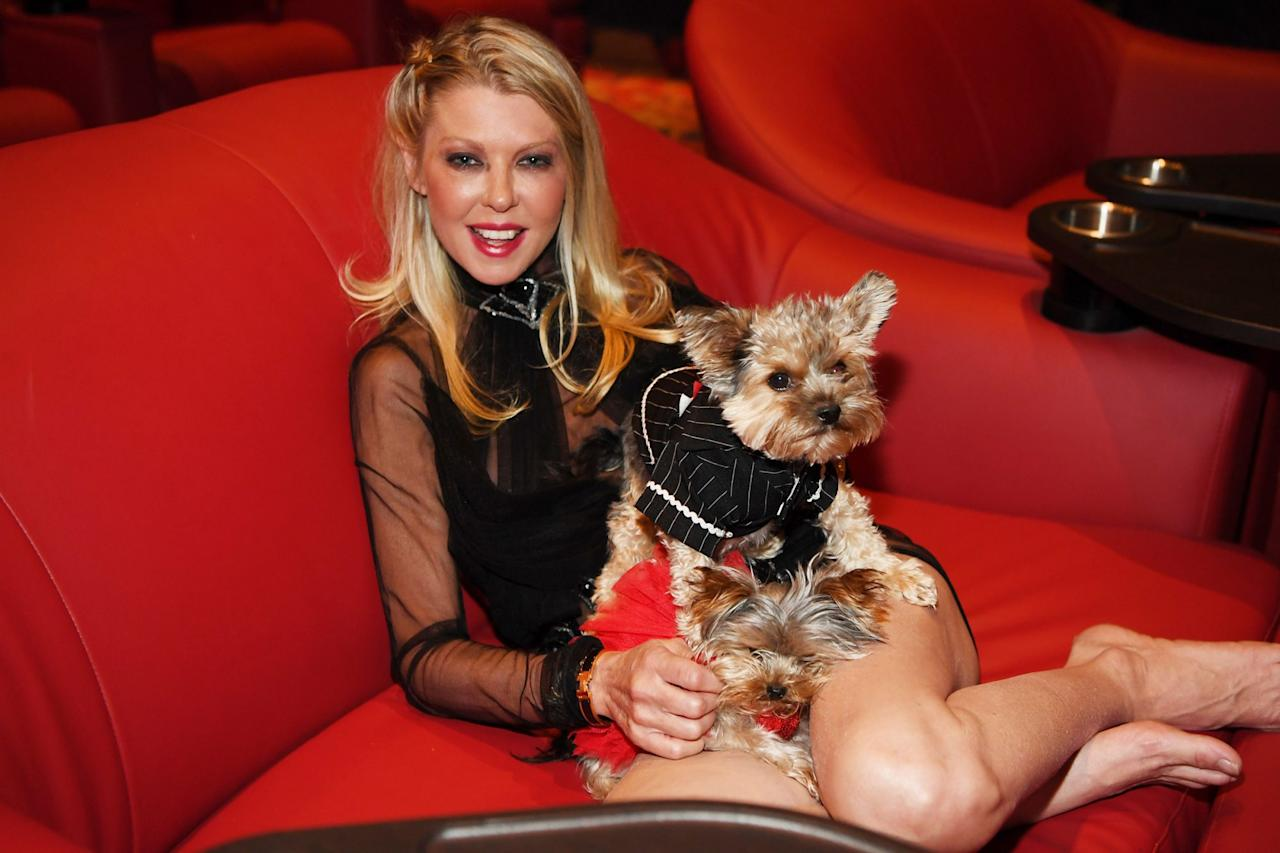 <p>Tara Reid snuggles up with her dogs at the release of her new movie <i>Attack of the Unknown</i> at Galaxy Theatres Boulevard Mall on Friday in Las Vegas.</p>
