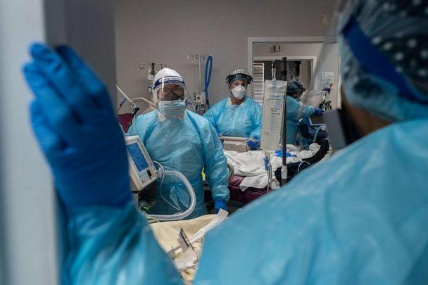 PHOTO: Medical staff members prepare for an intubation procedure on a patient suffering in the COVID-19 intensive care unit at the United Memorial Medical Center, Nov. 19, 2020, in Houston. (Go Nakamura/Getty Images)