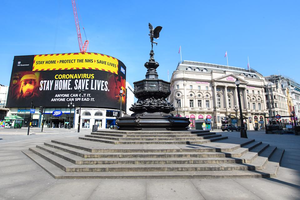Adverts encouraging people to stay at home are displayed in an empty Picadilly Circus, as the UK continues its lockdown to help curb the spread of the coronavirus. Picture date: Thursday April 9, 2020. Photo credit should read: Matt Crossick/Empics