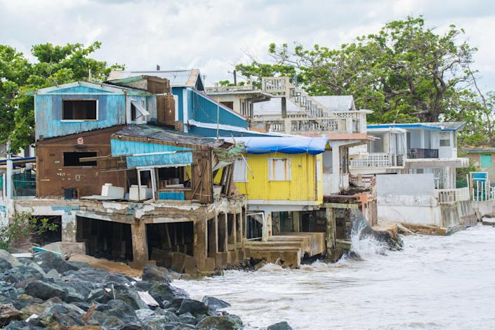 <p>Seaside scene in Rincon, Puerto Rico after Hurricane Maria in 2017. Today a new report claims that the Trump administration delayed financial aid</p> (Getty)