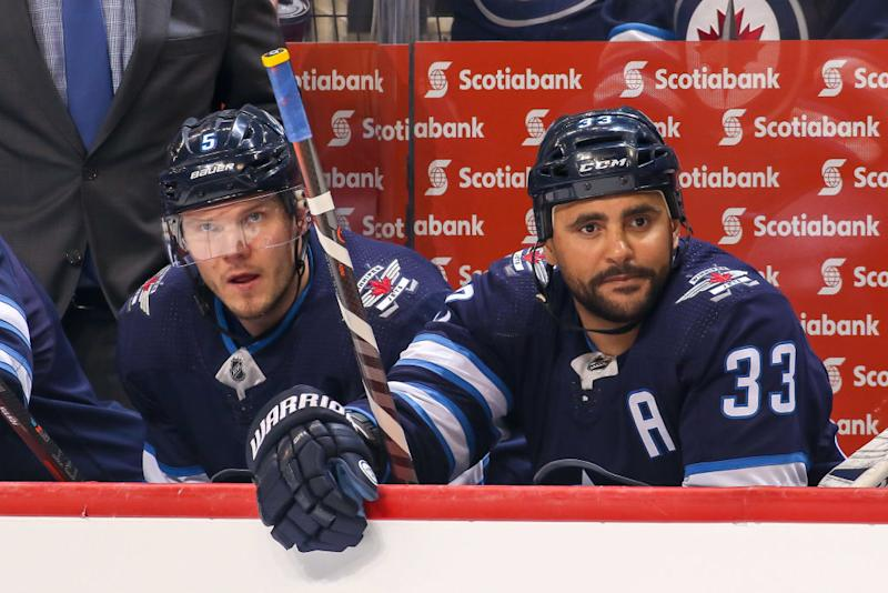 Dustin Byfuglien reportedly won't be making a decision regarding his NHL future anytime soon. (Getty)