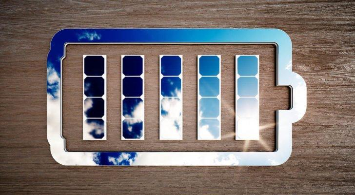 An image of the outline of a battery reflecting a blue sky with light clouds.