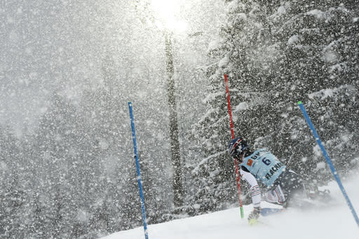 France's Clement Noel speeds down the course during the second run of an alpine ski, men's World Cup slalom in Flachau, Austria, Saturday, Jan. 16, 2021. (AP Photo/Gabriele Facciotti)