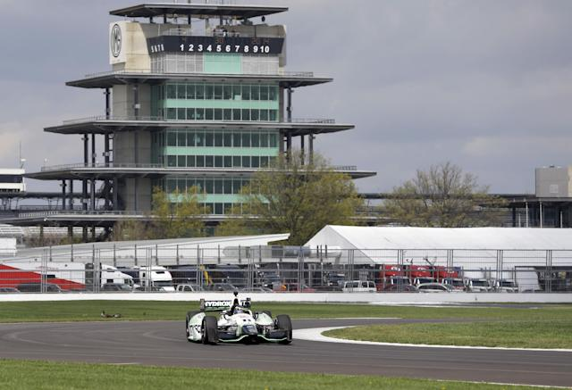 Sebastien Bourdais, of France, takes a turn during testing for the inaugural Grand Prix of Indianapolis auto race on the new road course at Indianapolis Motor Speedway in Indianapolis, Wednesday, April 30, 2014. (AP Photo/Michael Conroy)