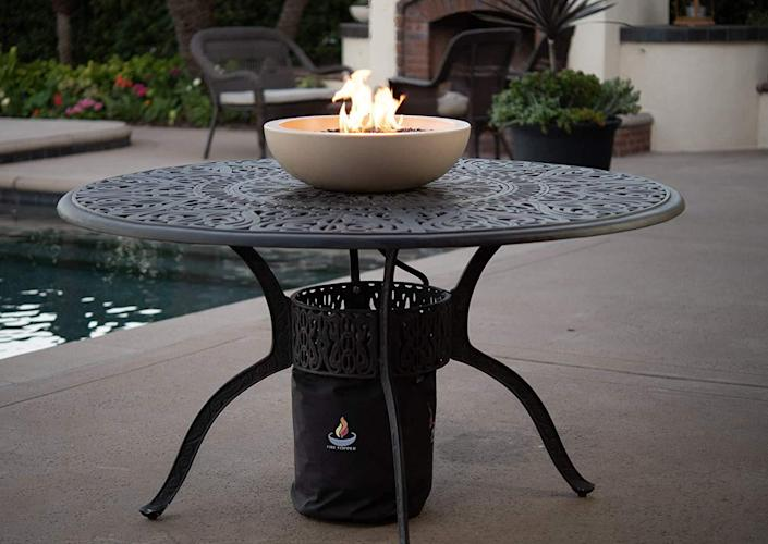 """Give your table a makeover with a petite tabletop fire pit like this one. It's available in Suffolk tan (pictured) or pearl gray. $289, Amazon. <a href=""""https://www.amazon.com/Patio-Table-Fire-Bowl-Propane/dp/B01FMWA8LQ/ref=sr_1_9"""" rel=""""nofollow noopener"""" target=""""_blank"""" data-ylk=""""slk:Get it now!"""" class=""""link rapid-noclick-resp"""">Get it now!</a>"""