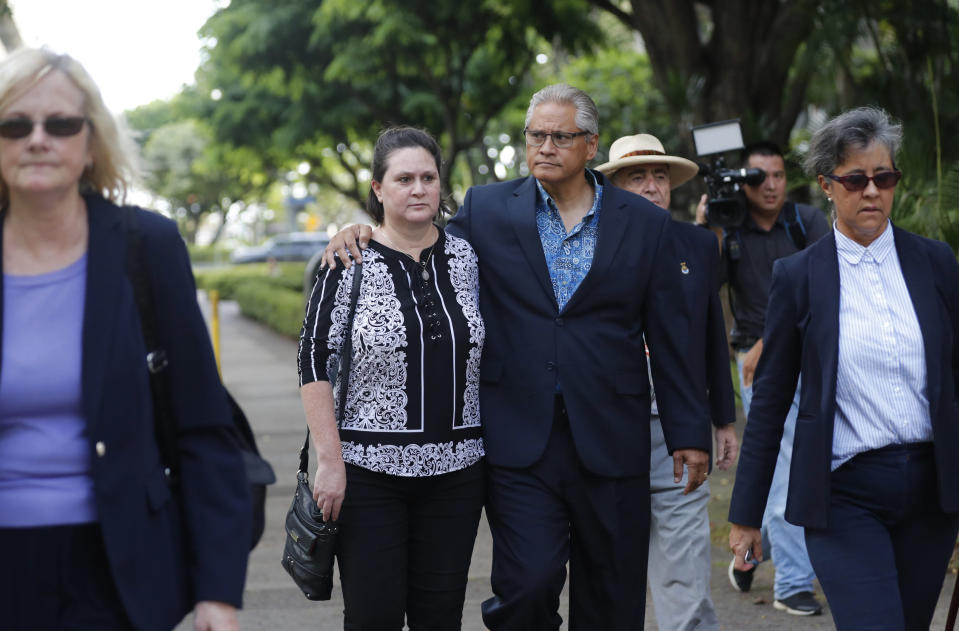 FILE - In this June 27, 2019 file photo Former deputy prosecutor Katherine Kealoha, center left, and husband, former Honolulu police chief Louis Kealoha, center right, walk toward Queen Street after the verdict in their corruption case at federal court in Honolulu. The Honolulu police chief and his wife convicted of conspiracy are pleading guilty in remaining cases against them. Jurors in June convicted the Kealohas in a plot to frame a relative to keep him from revealing fraud that financed their lavish lifestyle. (Cindy Ellen Russell/Honolulu Star-Advertiser via AP, File)
