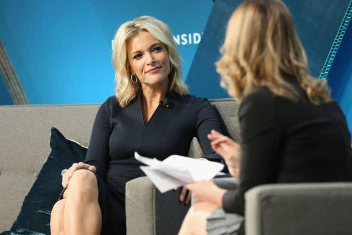 Megyn Kelly sitting on a couch and smiling at another woman
