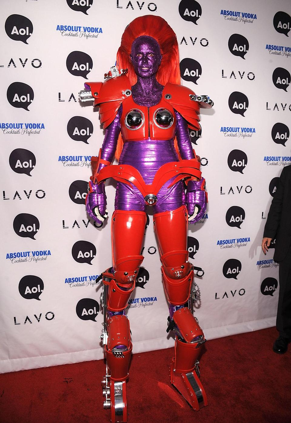 "<p>We actually have <em>no</em> clue what Klum is here, TBH. A robot? Transformer? Power Ranger? Can't be sure. Regardless, her hair, makeup, and costume are on point.</p> <p><strong>Get the look:</strong> <a href=""https://amzn.to/2ImDttd"" rel=""nofollow noopener"" target=""_blank"" data-ylk=""slk:Mehron Makeup Paradise Makeup Purple Face & Body Paint, Amazon ($12.30)"" class=""link rapid-noclick-resp"">Mehron Makeup Paradise Makeup Purple Face & Body Paint, Amazon ($12.30)</a>, <a href=""https://www.sephora.com/product/the-rainbow-eyeshadow-palette-P429027?icid2=products%20grid:p429027:product"" rel=""nofollow noopener"" target=""_blank"" data-ylk=""slk:Violet Voss The Rainbow Eyeshadow Palette, Sephora ($30)"" class=""link rapid-noclick-resp"">Violet Voss The Rainbow Eyeshadow Palette, Sephora ($30)</a>, <a href=""https://amzn.to/2OjOhgM"" rel=""nofollow noopener"" target=""_blank"" data-ylk=""slk:Forum Outta Space Robot Costume, Amazon ($54.87)"" class=""link rapid-noclick-resp"">Forum Outta Space Robot Costume, Amazon ($54.87)</a>, <a href=""https://amzn.to/2IlnlrG"" rel=""nofollow noopener"" target=""_blank"" data-ylk=""slk:Mirrored Wrap-Around Glasses, Amazon ($6.25)"" class=""link rapid-noclick-resp"">Mirrored Wrap-Around Glasses, Amazon ($6.25)</a>, and <a href=""https://amzn.to/2DBXiOq"" rel=""nofollow noopener"" target=""_blank"" data-ylk=""slk:Fever Smiffy's Women's Space Cadet Costume, Amazon ($33.56–$36.36)"" class=""link rapid-noclick-resp"">Fever Smiffy's Women's Space Cadet Costume, Amazon ($33.56–$36.36)</a></p>"