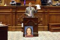 State Sen. Richard Cash, R-Powdersville, speaks about a bill that would ban almost all abortions in the state while showing a photo of a woman he said was born from a pregnancy caused by rape on Wednesday, Jan. 27, 2021, in Columbia S.C. The Senate passed the bill on an initial vote. (AP Photo/Jeffrey Collins)