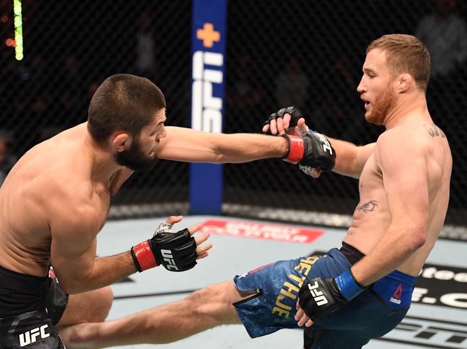 Khabib Nurmagomedov (left) in his final bout, against Justin Gaethje (Zuffa LLC via Getty Images)