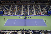 Sloane Stephens, of the United States, right, serves to Coco Gauff, of the United States, during the second round of the US Open tennis championships, Wednesday, Sept. 1, 2021, in New York. (AP Photo/John Minchillo)