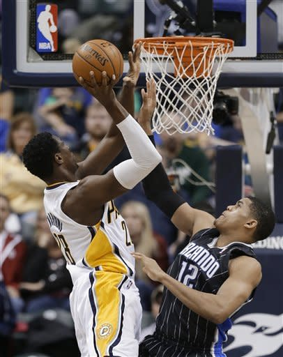 Indiana Pacers' Ian Mahinmi (28) is fouled by Orlando Magic's Tobias Harris (12) as he goes up for a shot during the first half of an NBA basketball game Tuesday, March 19, 2013, in Indianapolis. (AP Photo/Darron Cummings)
