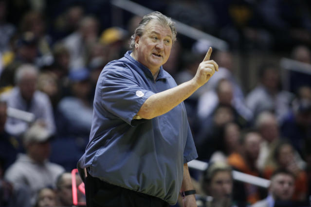 West Virginia head coach Bob Huggins disagrees with a referees call during the first half of an NCAA college basketball game against Oklahoma State Saturday, Jan. 12, 2019, in Morgantown, W.Va. (AP Photo/Raymond Thompson)