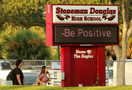FILE PHOTO: Students arrive for the the first day of classes at Marjory Stoneman Douglas High School in Parkland