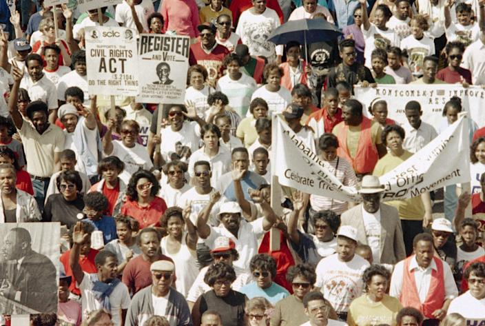 Thousands of demonstrators march to the Alabama Capitol completing the final leg of the 25 anniversary of the 1965 Selma to Montgomery civil rights march in Montgomery on Saturday, March 10, 1990. The marchers began their trek at the Edmund Pettus Bridge in Selma.