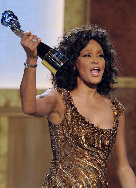 "FILE - In this Saturday, Jan. 16, 2010 picture, Whitney Houston accepts an award at the Warner Theatre during the 2010 BET Hip Hop Honors in Washington. Houston was the ""top trending"" search of the year, according to Google Inc. People around the globe searched en masse for news about the superstar singer's sad, accidental drowning (AP Photo/Nick Wass, file)"