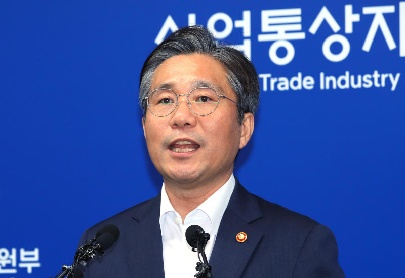 South Korean Trade Minister Sung Yun-mo speaks during a press conference at the government complex in Sejong, South Korea, Monday, Aug. 12, 2019. South Korea says it has decided to remove Japan from a list of nations receiving preferential treatment in trade in what was seen as a retaliatory move to Tokyo's recent decision to downgrade Seoul's trade status. (Jin Sung-chul/Yonhap via AP)