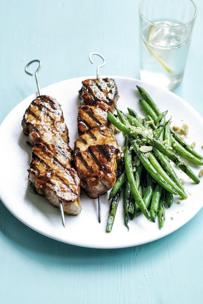 """<p>Give pork skewers big flavor with this sweet and savory glaze. </p><p><a href=""""https://www.womansday.com/food-recipes/food-drinks/recipes/a55355/peanut-butter-barbecue-pork-kebabs-recipe/"""" rel=""""nofollow noopener"""" target=""""_blank"""" data-ylk=""""slk:Get the Peanut Butter Barbecue Pork Kebabs recipe."""" class=""""link rapid-noclick-resp""""><em>Get the Peanut Butter Barbecue Pork Kebabs recipe.</em></a></p>"""