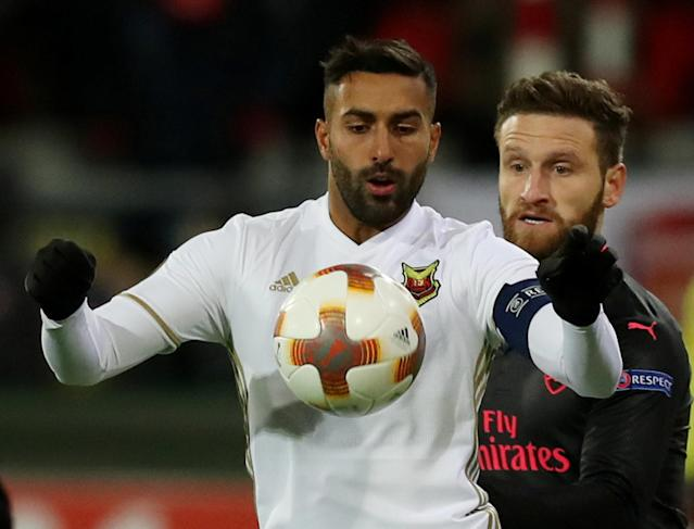 Soccer Football - Europa League Round of 32 First Leg - Ostersunds FK vs Arsenal - Jamtkraft Arena, Ostersund, Sweden - February 15, 2018 Ostersunds FK's Saman Ghoddos in action with Arsenal's Shkodran Mustafi Action Images via Reuters/Peter Cziborra