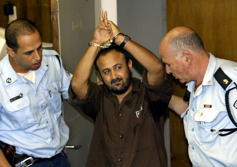 FILE PHOTO: Marwan Barghouti, a popular Palestinian leader, gestures as Israeli police bring him into the District Court for his judgment hearing in Tel Aviv