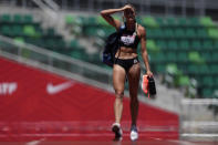 Heat waves come off the track as Annie Kunz walks to the heptathlon long jump at the U.S. Olympic Track and Field Trials Sunday, June 27, 2021, in Eugene, Ore. (AP Photo/Ashley Landis)
