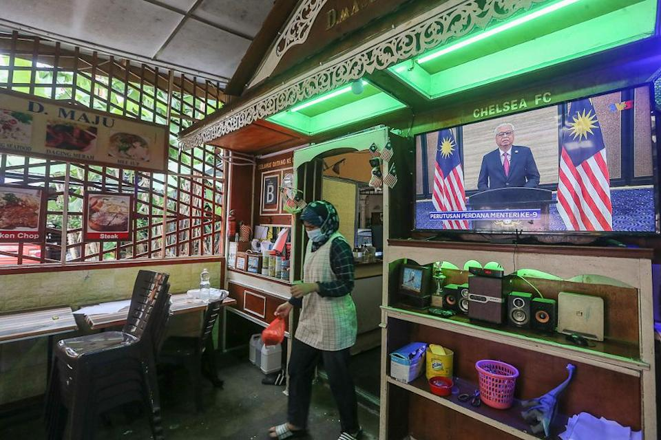 A live telecast of Prime Minister Datuk Seri Ismail Sabri Yaakob's speech is seen at a restaurant in Kuala Lumpur August 22, 2021. — Picture by Yusof Mat Isa
