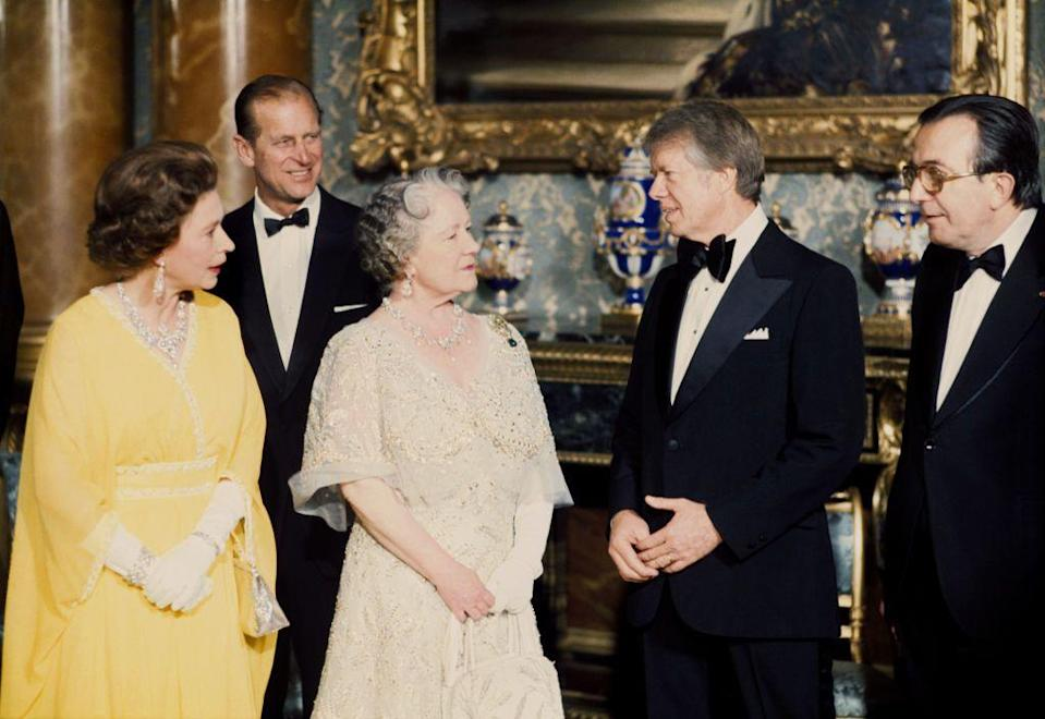 <p>The Queen Mother was called on to help Queen Elizabeth II and Prince Philip welcome President Jimmy Carter to Buckingham Palace in 1977. The dutiful monarch pulled out all the stops for the state dinner, wearing a gold embroidered tulle evening gown and plenty of royal jewelry. </p>